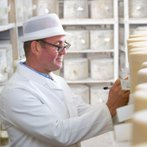 555_Dairy_worker_inspecting_cheese_plant-4